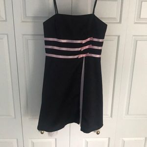 Black dress with pink ribbons